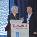 Jim Borneman, Editor in Chief, Textile World presenting the 2015 Innovation Award to The Quantum Group's founder, Jeff Bruner