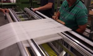 Figure 4c: The two warp sheets are being prepared for tying-in