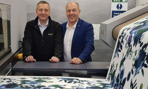 Stephen Thomas (left), managing director, Standfast & Barracks; and Martin Winkler, segment manager, Durst Textile Printing, reviewing fabric prints produced on the Durst Alpha 190 system.